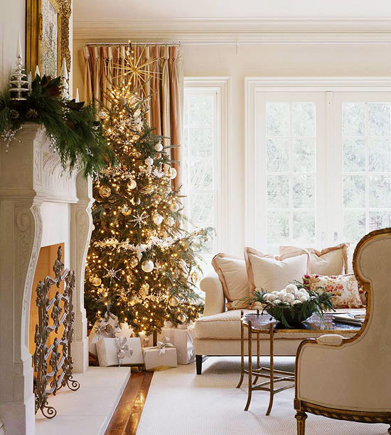 Gold and silver decorations sparkle in cream colored holiday living room