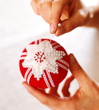 Embellishing ornament with pearl-headed pins