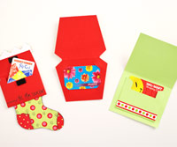 three holiday gift card holders open showing card