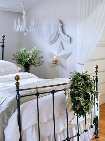 white master bedroom with wreath