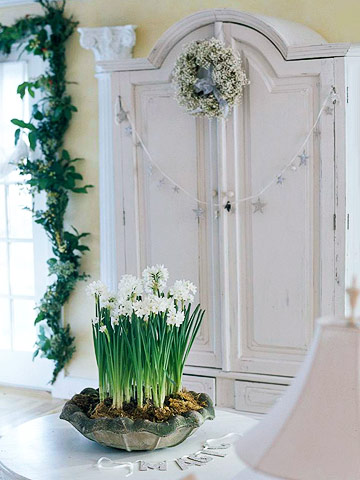 white armoire beside garland-ed window