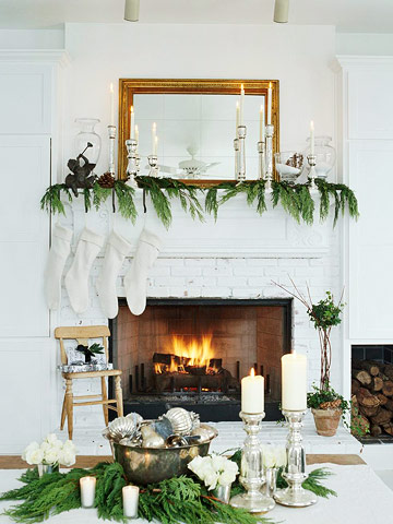 Holiday decorated fireplace mantel and table