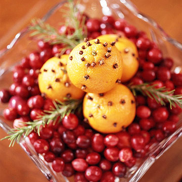 Detail fruit bowl oranges cranberries cloves-BHG