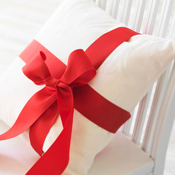 pillow tied with ribbon