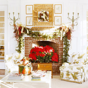 Fireplace with poinsettias in it, garland above, in a white living room