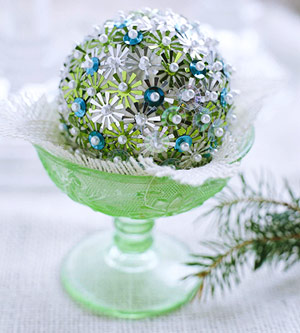 Ornament adorned with green sequins and pearl pins