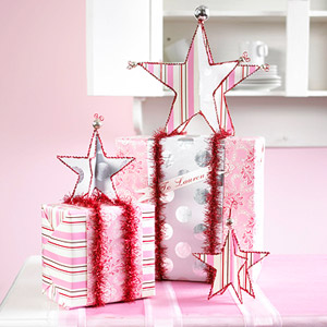 Two wrapped presents with stars on top