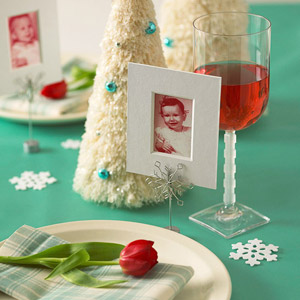 Place setting with small photo, flower, wine