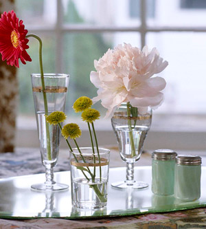 variety of flowers in glassware