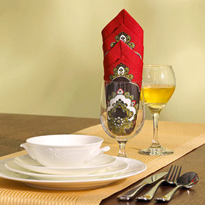 Table setting with towering diamonds folded napkin