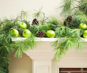 Mantle with garland made of geens, apples and pinecones