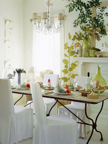 Thanksgiving dining room with flower and maple leaf decorations