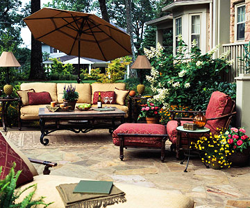 couch with umbrella and chaise lounge