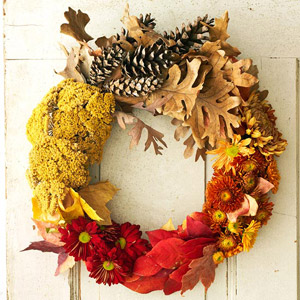 Thanksgiving wreath made of flowers, leaves and pinecones