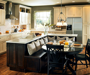 kitchen with white cabinets and banquette