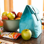 lunch bag and fruit on kitchen counter