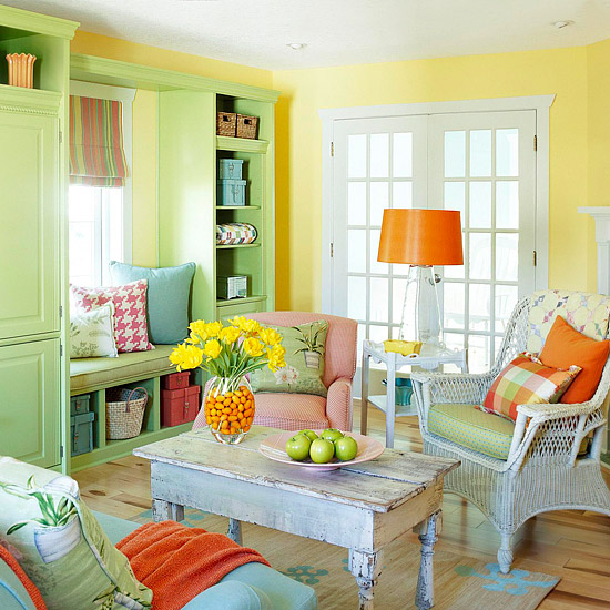 brightly colored living room with yellow walls and green armoire