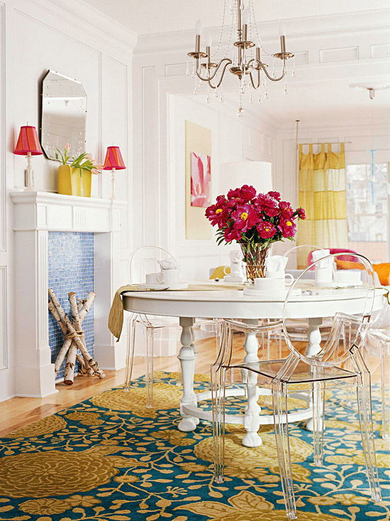 white dining room with blue and green rug