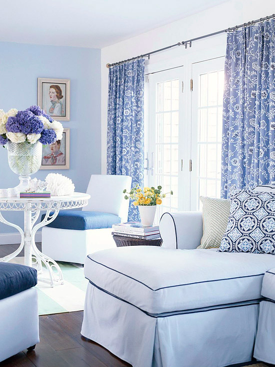blue, purple and white living room with white French doors and hydrangeas