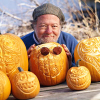 Zoom in man with pumpkins