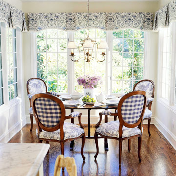 blue and white dining nook with round table and four chairs