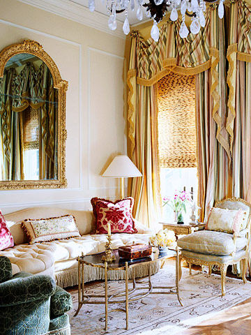 living room with drapes, valances and shades
