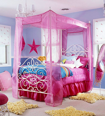 colorful canopy bed with yellow star throw rugs