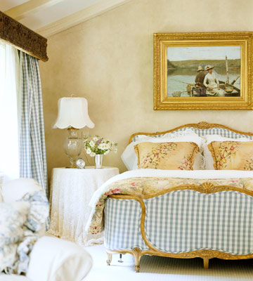 bedroom with blue gingham upholstered head and foot board