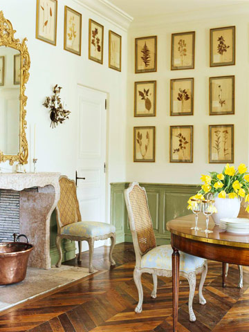 green and white dining room with botanical prints