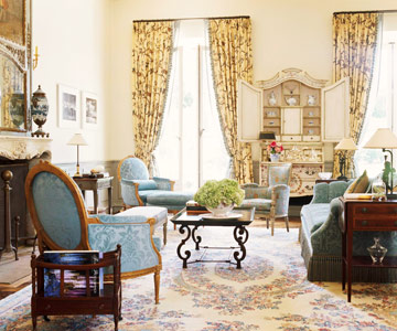 living room with blue damask furniture and yellow floral drapes