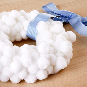 white wreath with blue ribbon