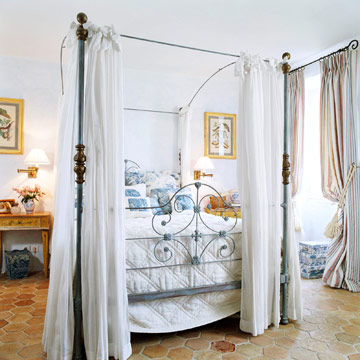 wrought iron bed in a blue and white bedroom