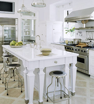 white and stainless steel kitchen with eat-in island