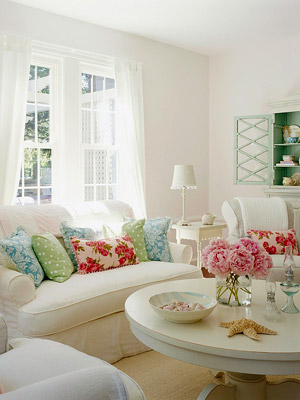white cottage living room with floral pillow accents