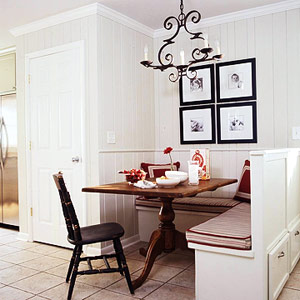 white banquette with red accents and drawers