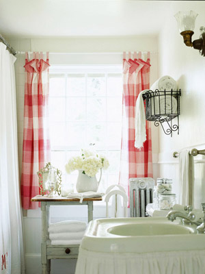 white bathroom with red and white plaid curtains
