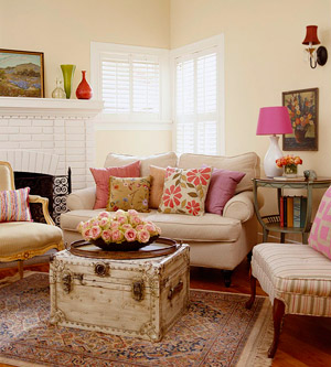 yellow and white living room with pink accents