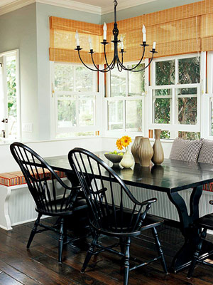 banquette with Windsor chairs and chandelier