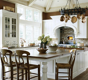 traditional kitchen with white cabinets and brick oven