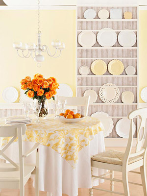 yellow walls with plate rack and orange roses