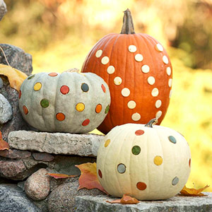 three spotted pumpkins
