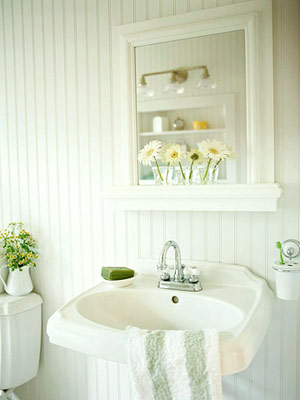 white bathroom with beaded board walls and pedestal sink