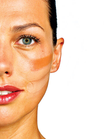 woman with foundation streaked on face