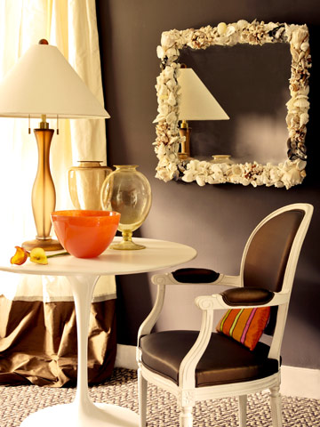 brown wall with shell mirror and brown chair