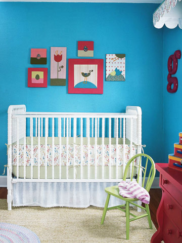 teal nursery with white crib and stitched artwork
