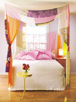 purple bedroom with fabric patchwork canopy