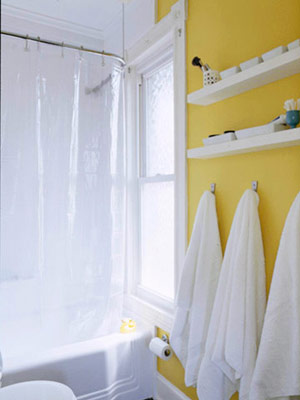 yellow wall--hooks and shallow shelves