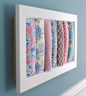 white frame with fabric rolls