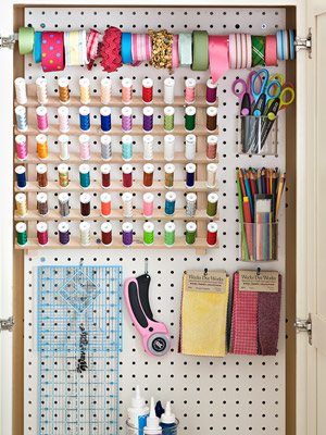 peg board covered in thread and ribbon