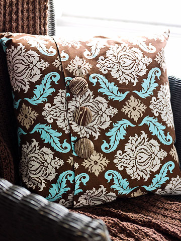 brown and blue pillow with buttons